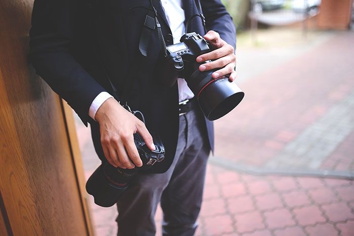 photographer with cameras